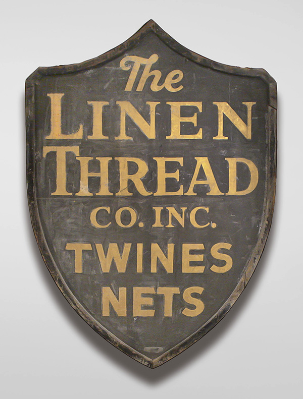 Advertising Sign for the Linen Thread Co. Inc., c.1940s, wood, metal, paint. Cape Ann Museum, Gloucester, MA. Gift of Steven Kaity, 2004 [#2004.20].