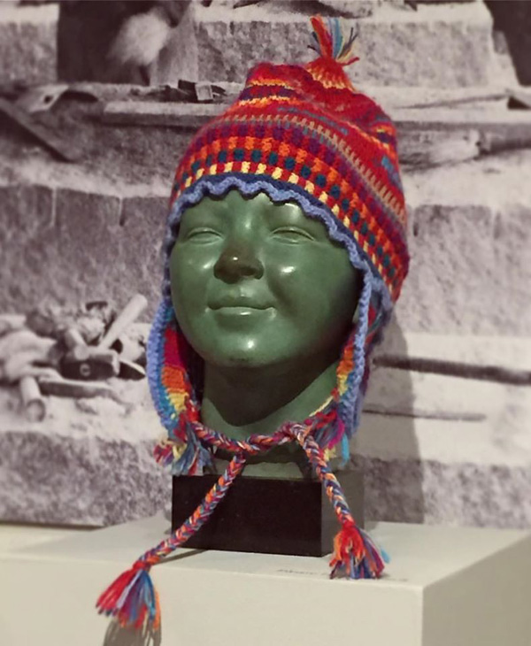 "Grace Murray knit hat atop George Demetrios (1896-1974), ""Marcia Gronblad: Finnish Girl"" 20th century, bronze. Gift of The George Demetrios Revocable Trust, 1990 [2532.4]."