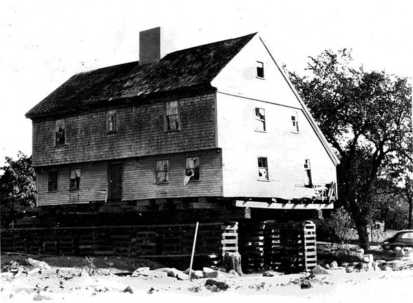 The White-Ellery House in the process of being moved, 1947.